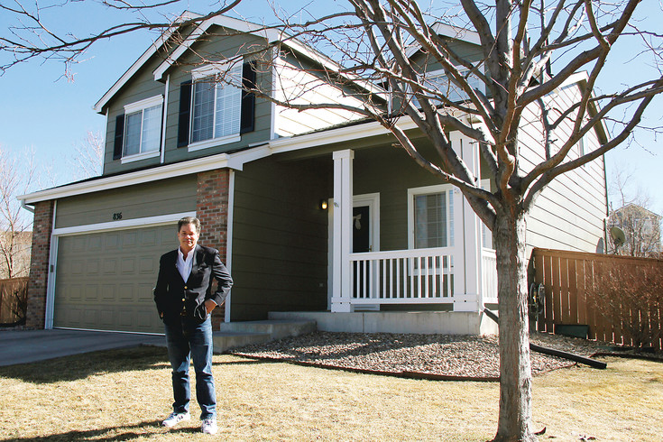 Bob Costello, a real estate agent based in Highlands Ranch, stands outside a house he owns and uses as a rental property. Costello says clients are using unconventional methods to get the advantage over others in the market, such as writing personal letters to sellers.