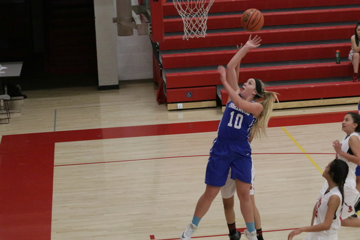 Molly Ostrowski puts a shot off the glass for Englewood during the Pirates girls basketball team's opening game against Jefferson. Ostrowski was the team's leading scorer this season as the Pirates were 11-11 overall and finished third in the district tournament, the best Pirate girls basketball season is a number of years.