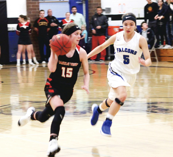 Castle View junior Abbie Cooley races up court with Tommi Olson of Highlands Ranch in pursuit in a Class 5A Sweet 16 playoff game Feb. 28 in the Falcons' gym.  The Sabercats lost a Sweet 16 game for the fifth time in six years as top-seeded Highlands Ranch rolled to a 60-36 victory.