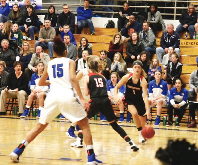 Castle View senior Brandi Bain drives toward the lane from the wing during the Sabercats' 60-36 loss on Feb. 28 to top-seeded Highlands Ranch in a Class 5A Sweet 16 game played in the Falcons' gym.