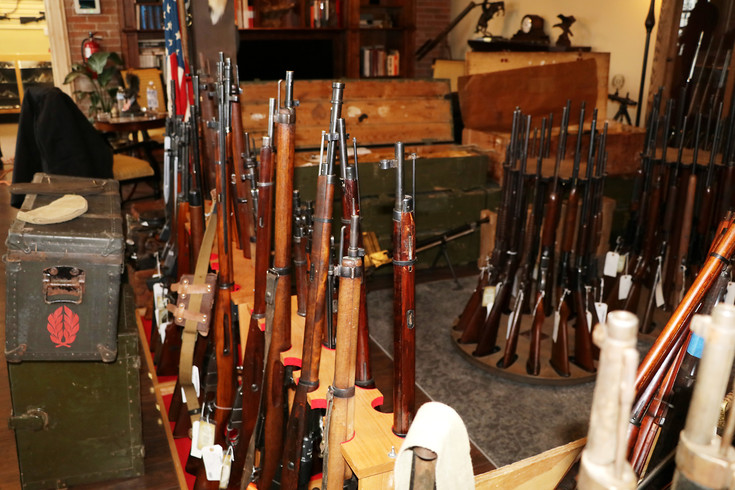 Racks of rifles are on display at the newly opened Old Steel shop in Englewood. Collector and owner Giovanni Galeano filled the store with guns, swords and knives as well as military equipment like helmets and ammo belts.