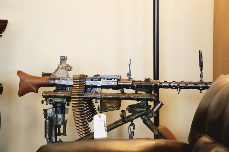 A MG34 World War II German machine gun is among the antique weapons displayed at the newly open Old Steel shop in Englewood. There are weapons ranging from guns to cross bows plus military memorabilia like helmets and medals in the shop at 12 E. Girard Ave.
