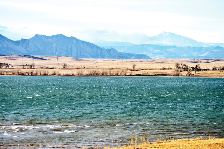 Clouds gather over the mountains overlooking Westminster's Stanley Lake. The lake one main reservoirs for Northglenn, Thornton and Westminster and local water district officials hope spring runoff from the mountains will fill the reservoir this spring.