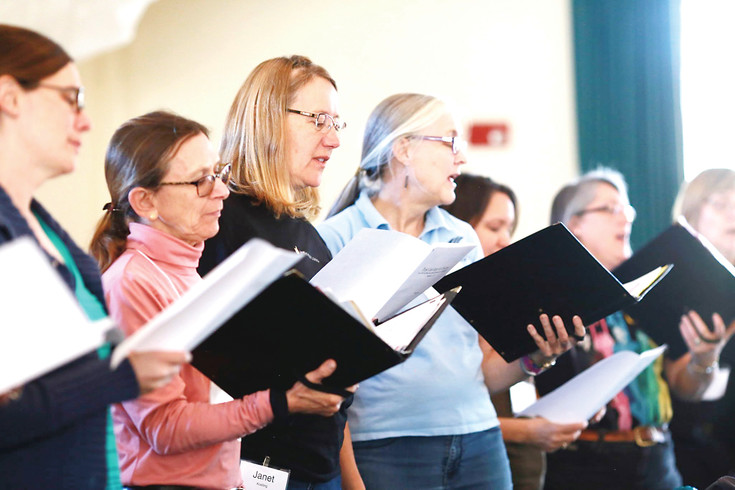 Arvada Chorale altos rehearse for their March performance of Johannes Brahms' German Requiem. From left: Kara Sakulich, Marty Lordier, Janet Koelling, Melinda McGann, Jennifer Sujansky, Diana Krueger and Lisa Greim.