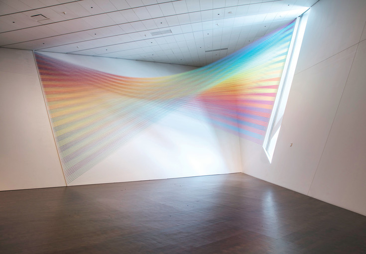 """Plexus"" 2016 by Gabriel Dawe, Guterman thread, painted wood and hooks, is installed in the ""Mi Tierra"" exhibition, a collection of works by 13 Latino artists reflecting a sense of place. It's at the Denver Art Museum through Oct. 22."
