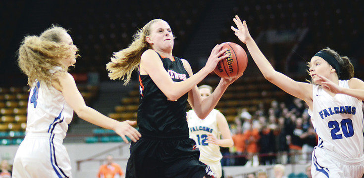 Lakewood junior Camilla Emsbo splits Highlands Ranch sophomore Tori Beck (4) and freshman Sarah Mitchell (20) during the first half March 3 at the Denver Coliseum. Emsbo had 21 points and 14 rebounds in the Tigers' 61-49 Class 5A state