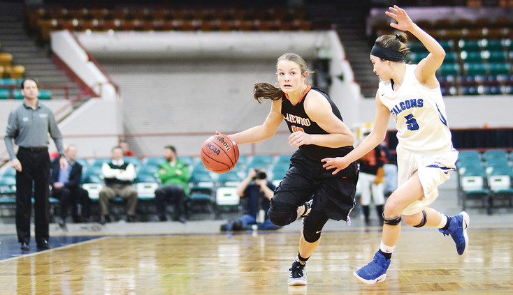 Lakewood junior Hannah Renstrom, left, drives on Highlands Ranch junior Tommi Olson during the Class 5A Great 8 game March 3 at the Denver Coliseum. Renstrom was clutch in the fourth quarter making 5-of-7 free throws to help seal the 61-49 victory for the Tigers.