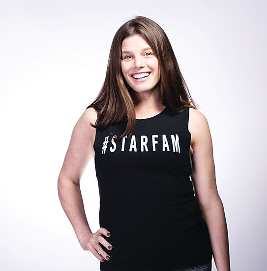 Anne Romano, mother, wife and co-owner of StarCycle, an indoor-cycling studio with a focus on charity.