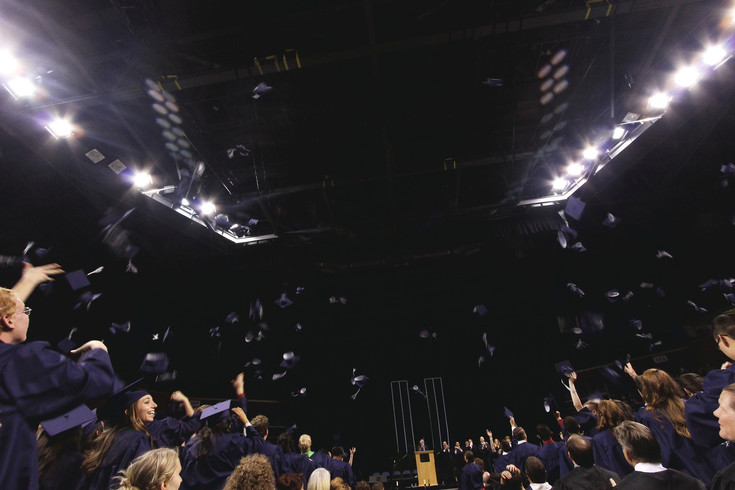 Hats in the air, the Standley Lake class of 2016 Gators celebrate.
