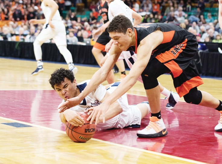 Valor Christian's Josh Randle, left, fights for the loose ball with Lewis-Palmer's Joel Scott.  The Eagles topped the Rangers 68-55 to win their first state title March 11 at the Denver Coliseum.