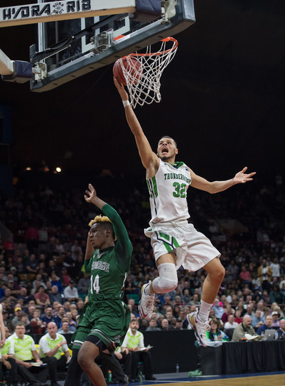ThunderRidge's Justin McCaw flies in for the layup as  George Washington defender Shawn'trell White tries to block. The Grizzlies lost in the semifinals to the Patriots on March 10 at the Denver Coliseum by the score of 61-56.