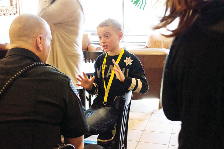Cullen Murphy talks to Deputy Brian McKnight on March 9 at Coffee with a Cop in Centennial. Murphy wanted to talk about how to react to the situation of a bad guy walking into Murphy's school. McKnight talked with Cullen for over half an hour about the run, hide, fight, treat, recover program taught in schools.