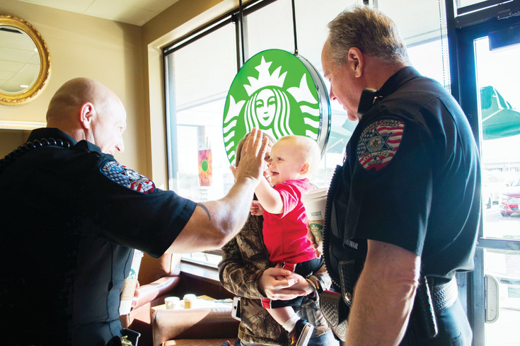 Sam Hayes enjoys meeting Arapahoe County sheriff's deputies at the Coffee with a Cop event in Centennial on  March 9.