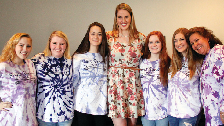 Olympic gold medalist Missy Franklin, center, stands with some of the 2017 Shine Summit organizers from Legend High School. Pictured from left to right are junior Savannah Bates, senior Steph Norden, sophomore Gabie Remy, Franklin, senior Lizzy Higgins, senior Kaitlin Ochs and Jan Graham, assistant activities director at Legend.