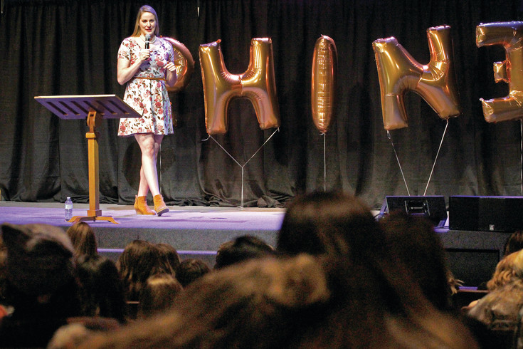 Olympic swimmer and five-time gold medalist Missy Franklin speaks about the importance of self-acceptance and unity among women at the Shine Summit in Cherry Hills Village. Franklin shared stories of her Olympic successes, and failures, to reinforce the message that vulnerability is critical to empowerment.