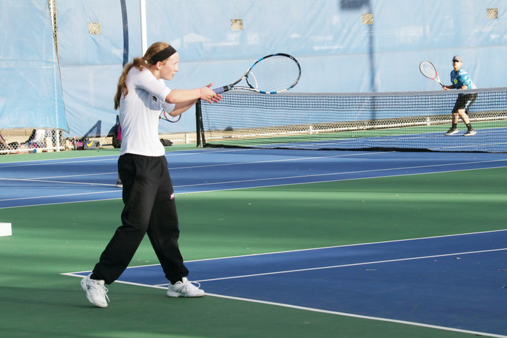 Lutheran's Sara Larson uses a backhand  to return a serve during the March 8 dual girls tennis match with Englewood. Larson won her match in straights sets, 6-1, 6-4 and the Lions won the match, 7-0.