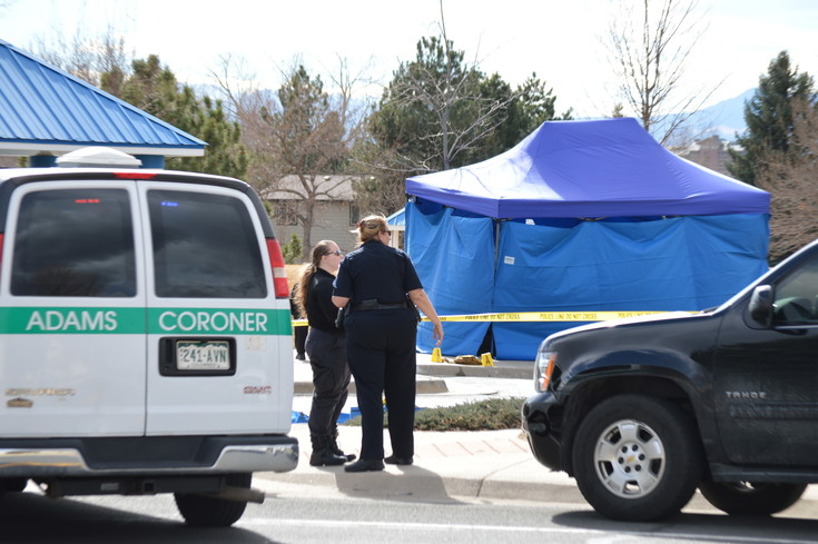 Police officers and the Adams County coroner investigate a Tuesday afternoon shooting at a Westminster park at 112th and Stuart Street. The blue tent in the background was put up to protect evidence.