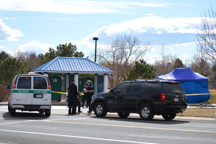 Police officers investigate a Tuesday afternoon shooting at a Westminster park at 112th and Stuart Street. The blue tent in the background was put up to protect evidence.