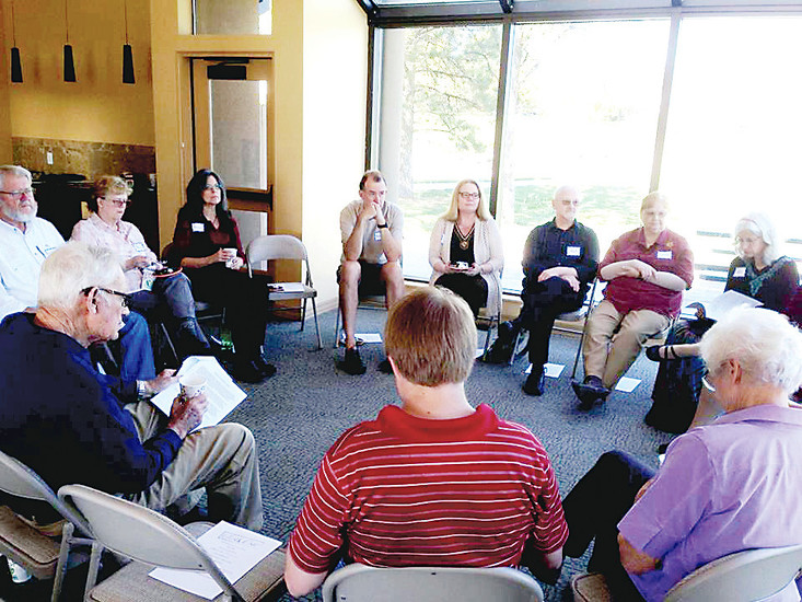 "Dave Lukaszewski helps lead a ""Death Cafe"" following a Sunday service at Prairie Unitarian Universalist Church in Parker, where members discuss the taboo topic of death to make it more comfortable for people, Lukaszewski said."