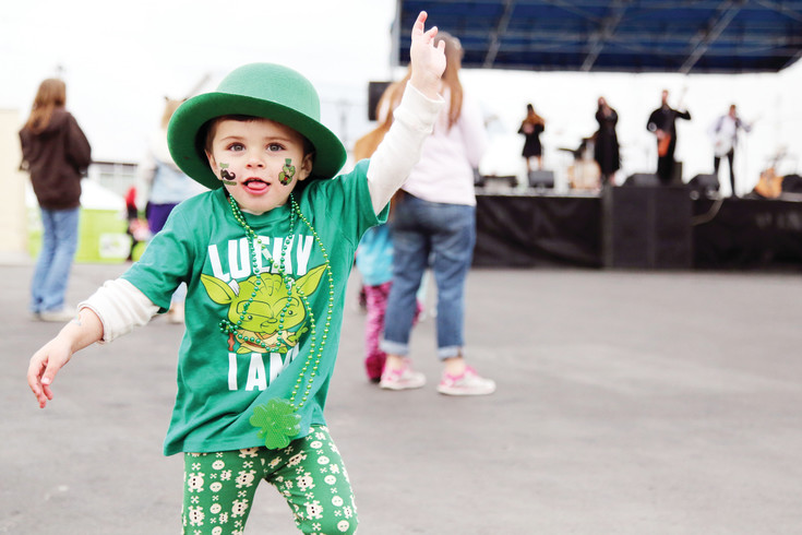 Avery Seamon, 3, dances to the celtic tunes of the band Wild Mountain.