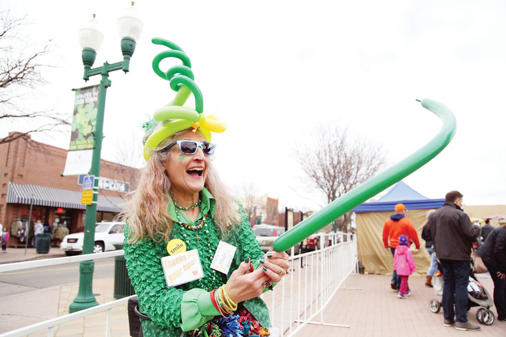Marty the magic Jewell makes balloon hats and animals at the in the square during the annual celebration.