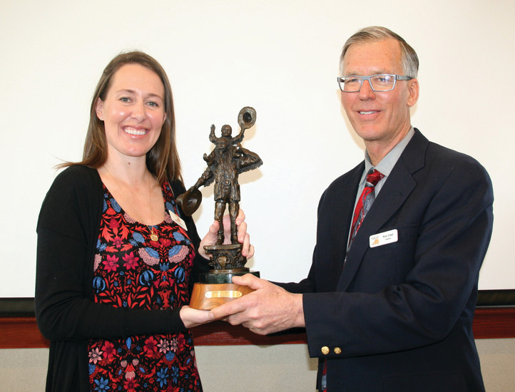 The Golden Civic Foundation's past president Sarah Lobosky receives her Howdy Folks/Buffalo Bill statue from the from the foundation's current president Dr. Rick Goad at the foundation's grant award luncheon on March 6. The mini statue is a replica of the one found in the median on Washington Avenue between 10th Street and the Clear Creek Bridge. The statue presentation has been a tradition for probably 20 years, Goad said, and all the former presidents receive one. But this year's statue is special — it is the first year that the Howdy Folks/Buffalo Bill statue has replaced the Lending a Helping Hand statue, which is also part of the City of Golden's public art collection, located on the southwest corner of 13th Street and Washington Avenue.