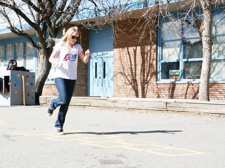 Sondia Ra, 12, a fifth grader at Pleasant View Elementary School in Golden plays hopscotch during recess. Ra joins others — fourth through sixth graders — taking advantage of the 20-minute recess on a sunny spring day.