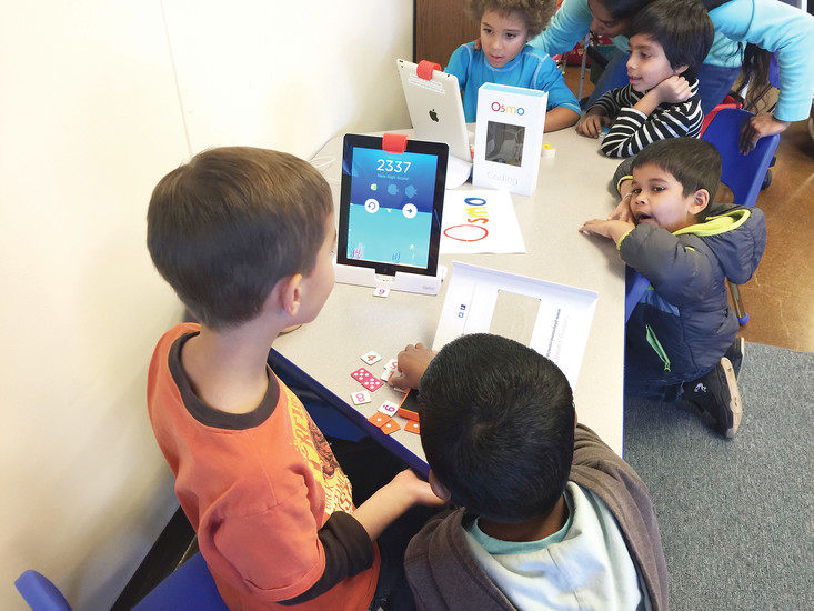 Students from  STEM School and Academy in Highlands Ranch work with iPads.