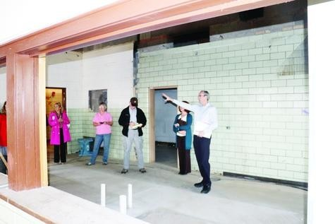Standing in the former Frutidale School's kitchen, Jim Hartman, TITLE with Hartman Ely Investments LLC, explains the new plans for redevelopment of the school into affordable housing.
