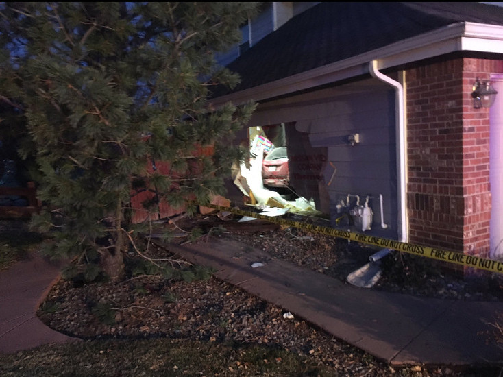 A car ends up in a residence garage after the driver fell asleep at the wheel in the early morning hours of March 15. Courtesy Douglas County Sheriff's Office