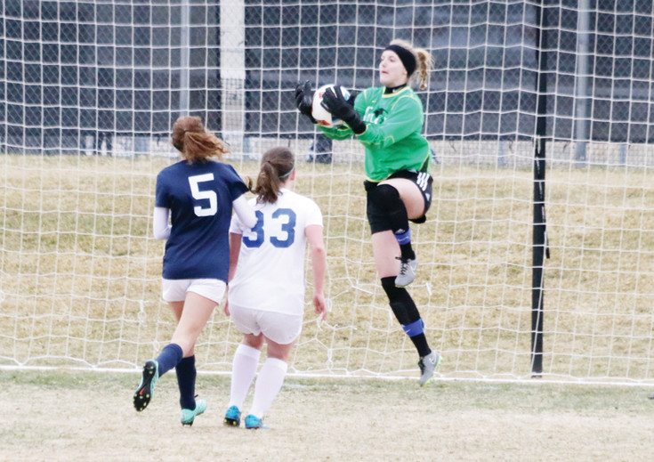 Highlands Ranch goalie Izzy DePinto leaps up and catches a shot on goal by Standley Lake during the March 11 girls soccer game. It was the opening game of the season for the Falcons and DePinto recorded eight saves as Highlands Ranch won the game, 1-0.
