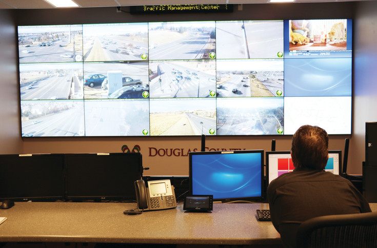 Duane Cleere, traffic operations manager at Douglas County, navigates the Douglas County Traffic Management Center in Lone Tree. The room features a video wall that allows staff to view county, Colorado Department of Transportation and Lone Tree traffic cameras, which are placed above busy roadways and intersections. Employees of the center have the ability to control signal times and LED traffic message boards.