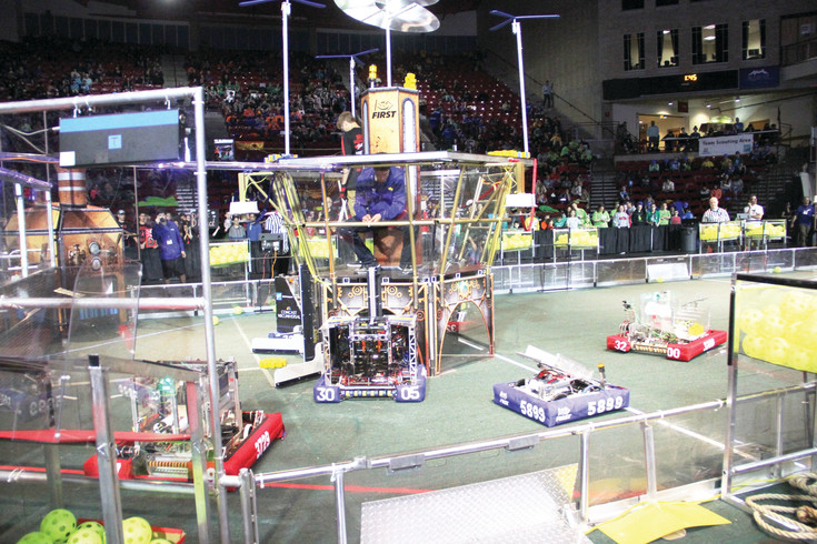 Robots compete at the Colorado regional of the FIRST Robotics Competition March 24 at the University of Denver.