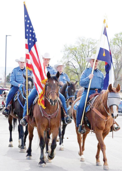 Horsemen with the Adams County Sheriff's Department lead a parade into Hyland Hills Recreation District's new 81-acre Clear Creek Valley Park March 23. The park is nearly a decade and a half in the making, as the district went through land acquisition, grant writing, FEMA permits, storm water permits and a slew of other similar steps.