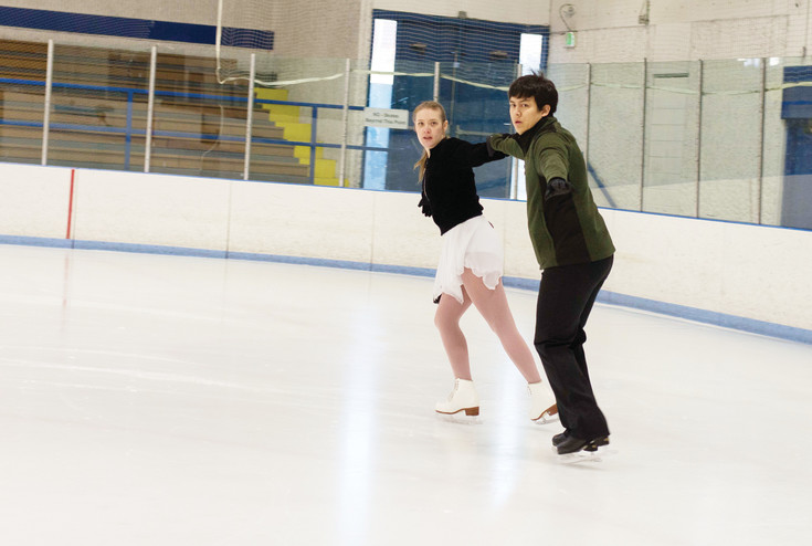 Amanda Douglas and Haldan Pranger practice for their pairs skating division competition on March 25 at the South Suburban Ice Rink.
