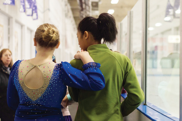 Two friends encourage each other before their figure skating division at the South Suburban Ice Rink, where Special Olympics athletes gathered to compete in state championships.