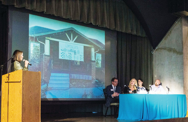 Lauren Burgess presents the nonprofit she co-founded, Dirt Coffee, to the panelists and potential donors at the South Metro Denver Chamber's event, The Tank, on March 23 at the Denver Botanic Gardens. Dirt Coffee received the most money, $7,291, for its mission of hiring individuals with autism as full-time employees.