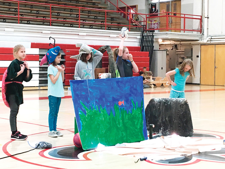 "The C.A.T.s, consisting of Free Horizon Montessori students, from left, Morgan Thompson, Emmerson Wells, Ayden Sidwell, Sierra Nordwald and Hannah Harr, perform their ""Under the Sea"" skit at the Destination Imagination regional competition, which took place March 11 at Jefferson High School in Edgewater. The C.A.T.s placed second overall and will advance to Destination Imagination's state competition on April 22 at Auraria Campus. Courtesy photo"