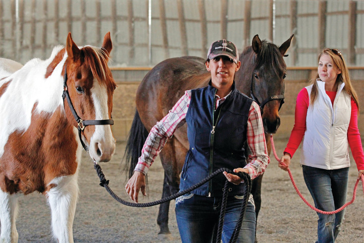 Jacqui Avis, left, and Andrea Mena lead a pair of four-legged friends on a walk at the Drifter's Hearts of Hope ranch in Franktown. The nonprofit horse rescue will host a 5K fun run at the Colorado Horse Park at 8 a.m. on April 22 to raise funds and compete for a $25,000 grant from the ASPCA.