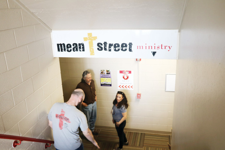 Mean Street Executive Director James Fry, center, talks with a volunteer and Outreach Director Todd Graber at  the organization's Lakewood shelter.