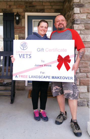 James Vines, pictured with wife Stephany Vines, accepts a free landscaping makeover from the Landscaping for Vets program.