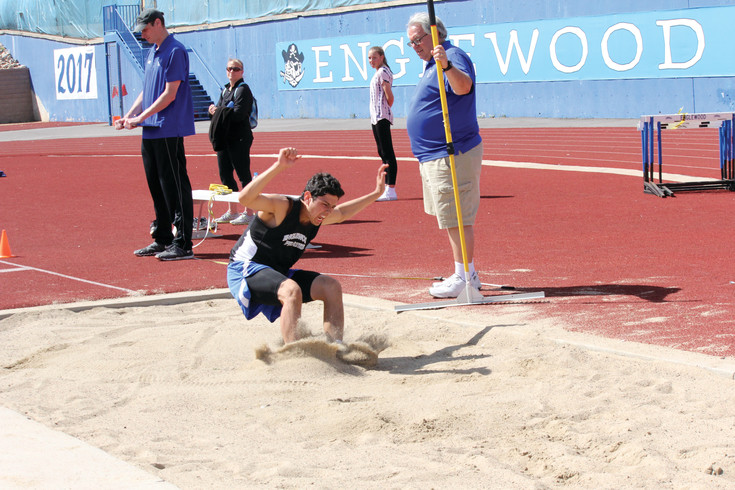 John Munoz competes in the long jump for Englewood during the April 8 Windjammer Invitational Track Meet. Munoz won the long jump and he also won the 200-meter dash as the Pirates took first place in the team standings at the six-team meet.