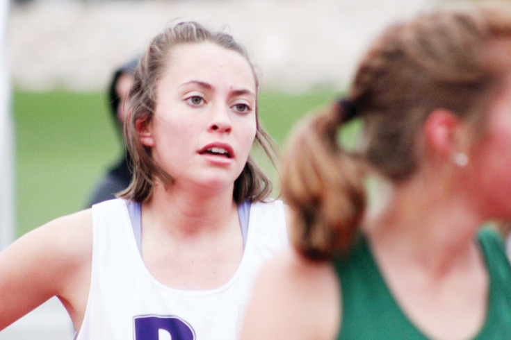 Douglas County junior Lina Corrales was the winner of the 800 and 1,600 races at the April 3 Highlands Ranch Invitational. She claims it takes heart to succeed in 800 meter runs and between races walks to stay loose and listens to music.