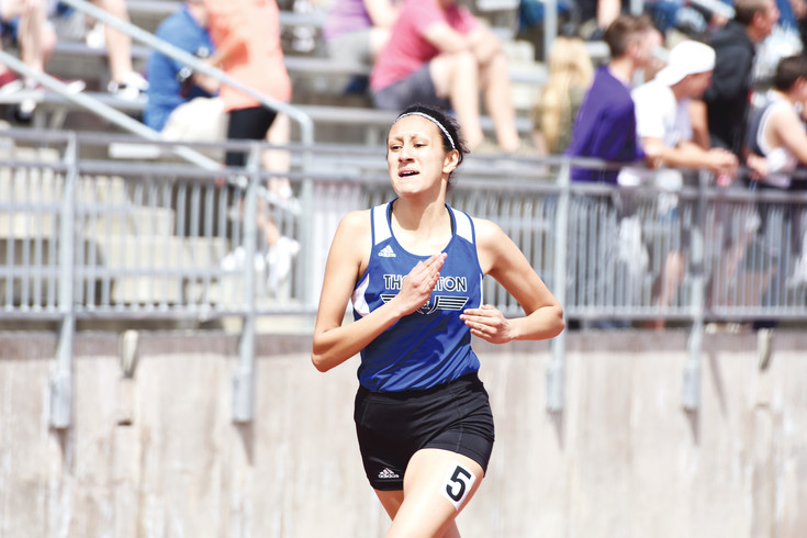 "Thornton junior Stephanie Carrasco cruises to victory in the girls 400 meter run at the Maxine Ehrmann Invitational track meet at Adams 12 North Stadium in Westminster on April 8. Carrasco clocked in at 62 seconds, without starting blocks, on her ""sprint"" day, during which she bypassed both the 1600 and 3200 meter runs."