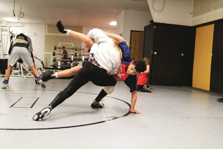 Jerzie Estrada takes down an opponent while training for an upcoming tournament at Sons of Thunder Wrestling Academy.