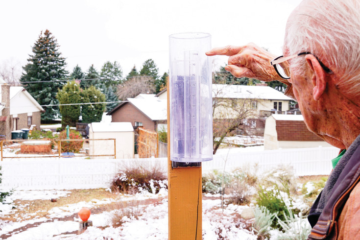 Thornton resident Steve Austin checks his rain gauge as part of an international effort to track precipitation. Austin, one of 20,000 volunteers around the globe, has submitted 3,569 daily reports to Community Collaborative Rain, Hail and Snow Network since 2005.
