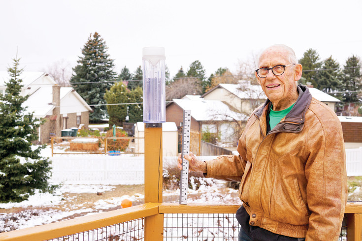 Thornton resident Steve Austin and the rain gauge he checks, part of an international effort to track precipitation. Austin, one of 20,000 volunteers around the globe, has submitted 3,569 daily reports to Community Collaborative Rain, Hail and Snow Network since 2005.