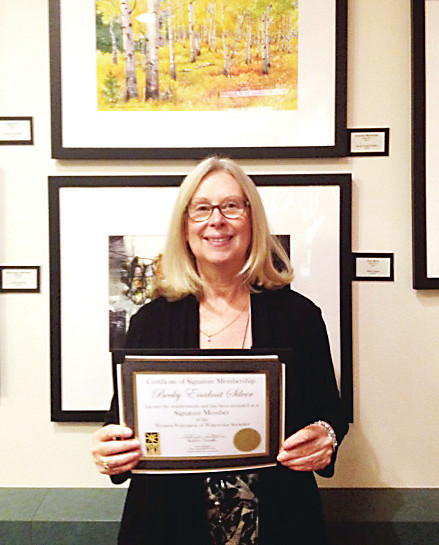 Becky Silver, owner of Aar River Gallery in Westminster, receives an award making her a signature member of the Western Federation of Watercolor Societies.