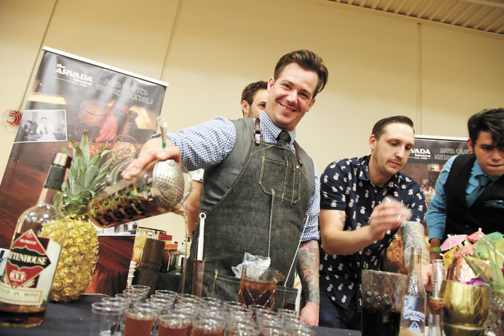 Arvada Tavern bartender Josh Sevy serves tiny Manhattans to Taste of Arvada attendees.