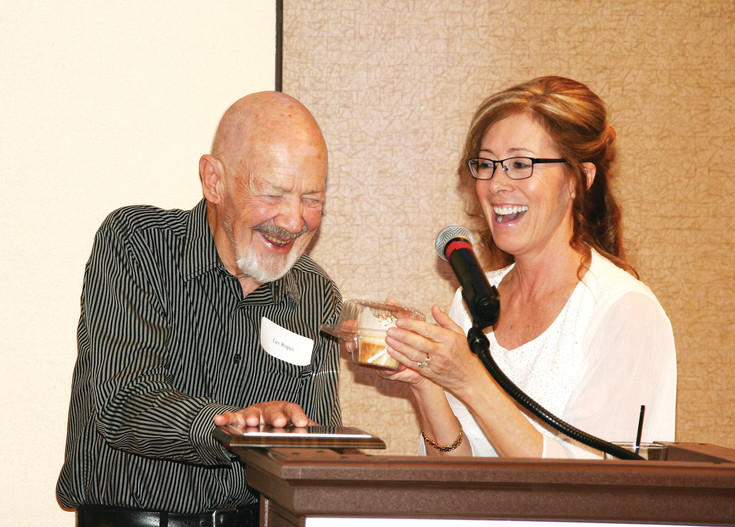 Goldenite Lev Ropes smiles as the Golden Chamber of Commerce's CEO and president Leslie Klane presents him with a cupcake in honor of his 82nd birthday. Ropes is the recipient of the chamber's President's Award, which recognizes a person for showing kindness and selflessly giving time and talents in support of the chamber's mission. The awards banquet took place Feb. 8.